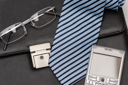 leather briefcase: Businessman accessories tie and phone over leather briefcase