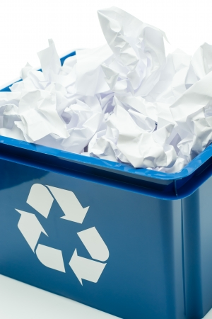 recycle paper: Blue recycling bin box with paper waste on white