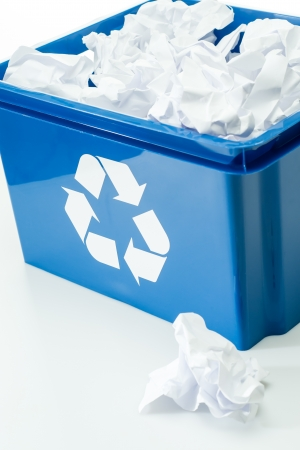Blue recycling box with paper waste bin on white background photo