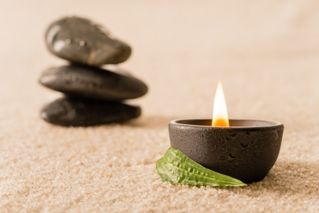 stone spa: Spa still life burning candle with zen stones