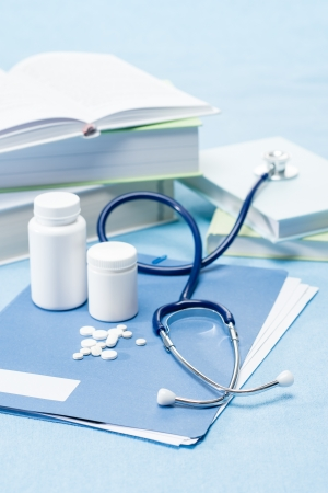 analgesics: Doctor accessories with medical pills on blue background