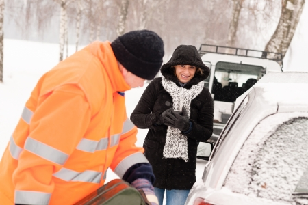 car trouble: Man filling gas tank car breakdown woman winter snow assistance