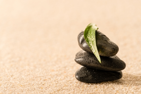 Spa zen stones with leaf on sand still nature photo