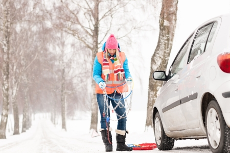 Woman holding tire chains car snow broken problems winter young photo