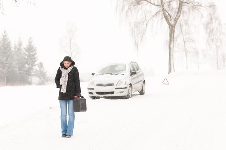 stuck: Woman walking with gas can snow car road winter trouble Stock Photo