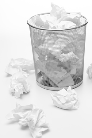 trashed: Office silver trash bin full of paper waste white isolated