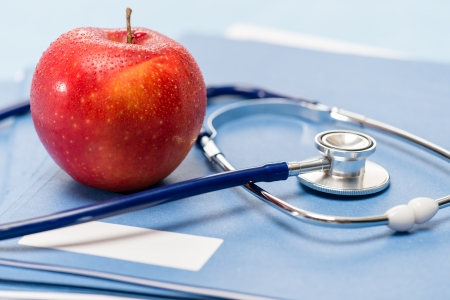 Healthcare red apple and medical stethoscope healthy lifestyle Stock Photo - 15754036