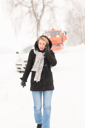 Woman calling for help broken car snow assistance winter road photo