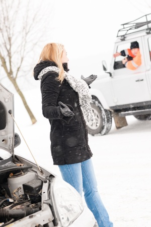 stuck up: Woman having trouble with car snow assistance winter talking man