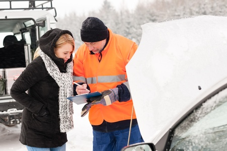 breakdown: Woman answering inquiry broken car snow mechanic assistance road winter Stock Photo