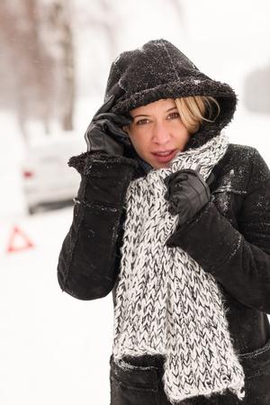 broken car: Woman with car breakdown snow accident road winter broken upset