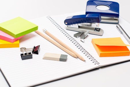 Variety of business office supplies on white notepad Stock Photo - 15808281