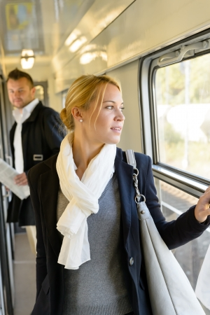 Man watching woman looking out the window train travel commuting Stock Photo - 16968329