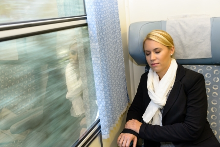compartment: Woman sleeping in train compartment tired resting commuter comfortable journey