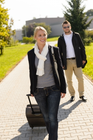 Woman leaving with baggage man walk behind friends commuter travel Stock Photo - 16968328