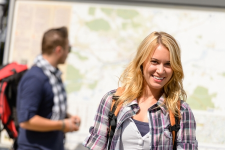 exuberance: Couple backpack traveling on holiday smiling map leisure woman man