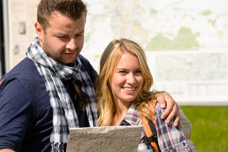 Couple together on holiday with map happy tourists directions trip Stock Photo - 16968399