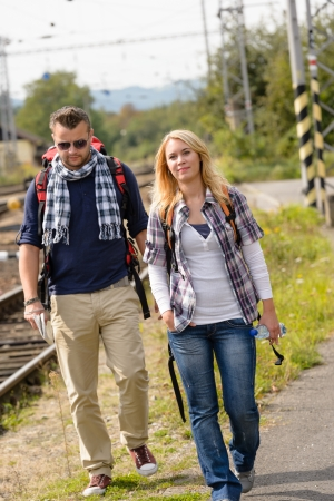 Couple walking with backpack in train station happy woman man Stock Photo - 16968362