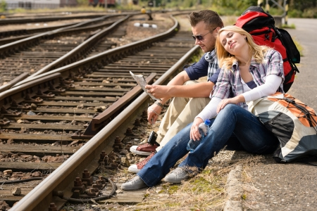 Couple resting looking at map railroad backpack travel vacation happy Stock Photo - 16968407