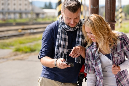 Man showing woman pictures on digital camera vacation couple smiling Stock Photo - 16968393