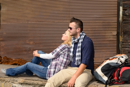 Couple resting backpack travel tired sitting trip woman man tourists Stock Photo - 16968404