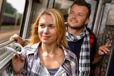 Couple in train looking out the window man woman happy Stock Photo - 16968339