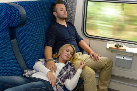 Couple sleeping in train woman man vacation romantic passengers laying Stock Photo - 16968387
