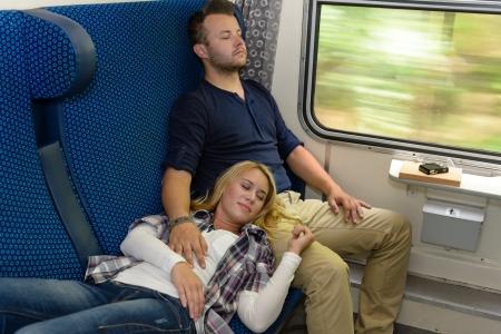 Couple sleeping in train woman man vacation romantic passengers laying Stock Photo - 16968387