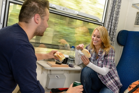 Couple eating sandwiches on train traveling smile vacation hungry lunch Stock Photo - 16968363