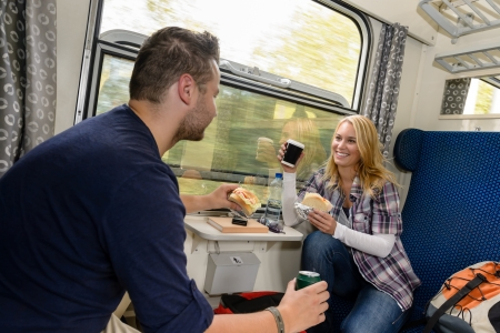 Couple enjoying sandwiches traveling with train smiling woman man vacation Stock Photo - 16968381
