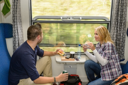 Man looking out the train window eating woman couple smiling Stock Photo - 16968389