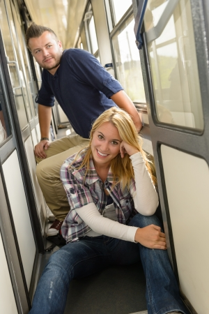 Couple sitting on train hall smiling vacation man woman traveling Stock Photo - 16968332