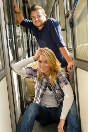 Woman and man sitting on train hall couple vacation smiling photo