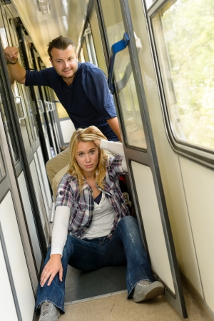 Woman and man sitting on train hallway frustrated couple vacation Stock Photo - 16968335