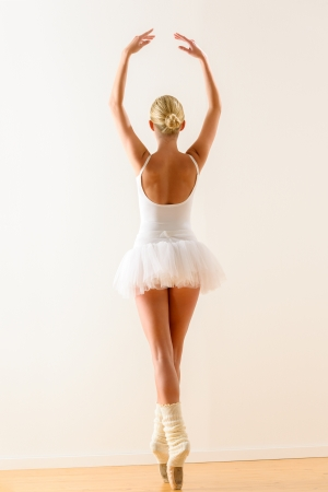 Rear view of ballerina standing on tiptoe with raised arms Stock Photo - 16955593