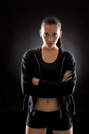 Portrait of sporty young woman on black background Stock Photo - 16969613