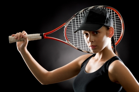 Black tennis- portrait of female player with racket Stock Photo - 16969640