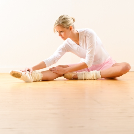 ballet slippers: Beautiful ballet dancer stretching in the studio woman ballerina exercise Stock Photo