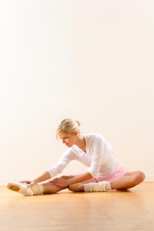 Ballet dancer in leaning posture exercise studio reaching woman ballerina Stock Photo - 16984869