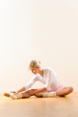 Ballet dancer in leaning posture exercise studio reaching woman ballerina Stock Photo - 16984869