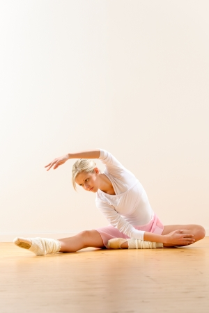 Ballet dancer in leaning posture exercise studio reaching woman ballerina Stock Photo - 16984870