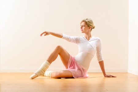 Beautiful woman dancer practicing ballet in studio ballerina arm raising Stock Photo - 16984875