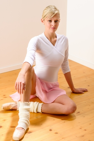 Ballet dancer sitting on the studio floor resting ballerina beautiful Stock Photo - 16984857