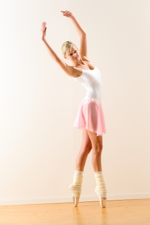 Ballerina standing on tiptoe with raised arms beautiful classical ballet Stock Photo - 16984853