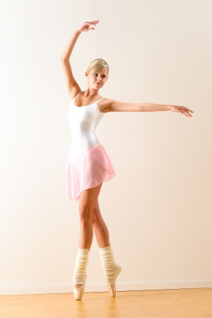 Ballet dancer standing on tiptoe with raised arms Stock Photo - 16984851