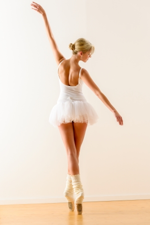 Beautiful ballet dancer dancing in the studio woman ballerina rehearsal photo