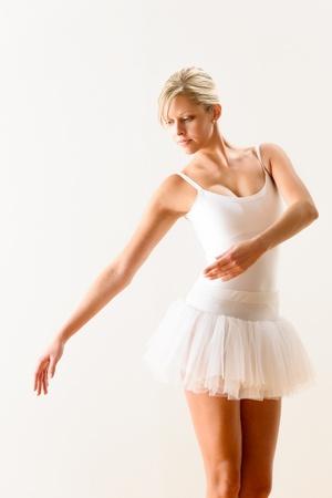 Ballet dancer exercising dance move in studio woman ballerina pose photo