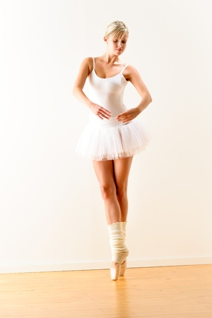 Ballerina exercising ballet pose in the studio woman beautiful dance photo