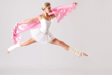 Lovely ballet dancer jumping exercising in studio woman ballerina rehearsal photo