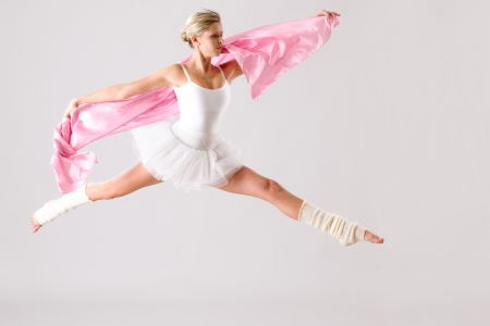 Lovely ballet dancer jumping exercising in studio woman ballerina rehearsal Stock Photo - 16984868